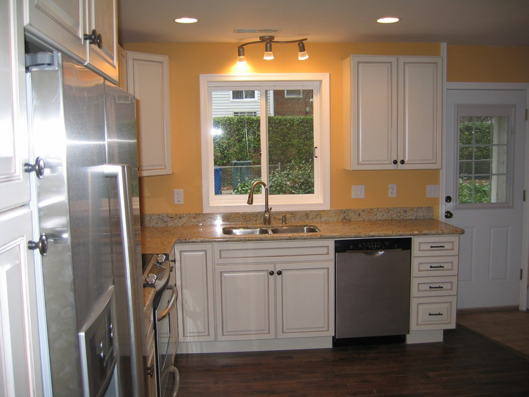 delightful Kitchen Remodeling Germantown Md #7: DC kitchen remodeling - white cabinets - cream white and black countertop  and yellow back splash